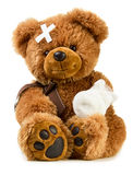 Teddy with bandage Stock Photos