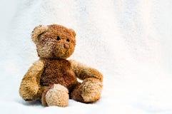 Teddy bear. Cute teddy bear on white towel Stock Image