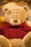 Teddy bear. Stuffed teddy bear toy in a red sweater hi-res image Stock Photo