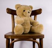 Teddy bear. The toy of a teddy bear sitting on a chair Royalty Free Stock Photos