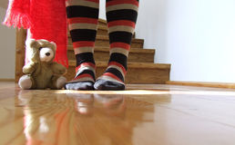 Teddy bear. A brown teddy bear with legs wearing striped socks Stock Image