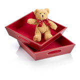 Teddy bear. With a red bow into toy boxes Stock Photos