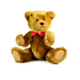 Teddy Bear. Soft teddy bear wearing a red bow tie with white polka dots. Copy space royalty free stock image