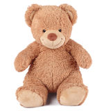 Teddy bear. Happy brown teddy bear sitting on a white background stock image