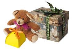 Teddy bear. With a cardboard gift box Stock Photography