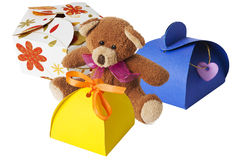 Teddy bear. With a cardboard gift box Stock Images