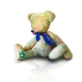 Teddy bear. An old tattered stuffed toy antique teddy bear made of a quilt material.  A reminder of times gone by Royalty Free Stock Image