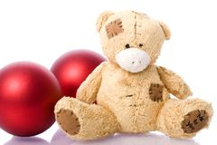 Teddy bear. A little teddy bear with red christmas balls Royalty Free Stock Photography