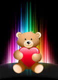 Teddy Bear on Abstract Spectrum Background Stock Photo