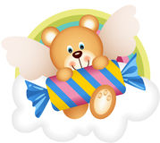 Teddy bear angel with candy on the cloud Stock Images