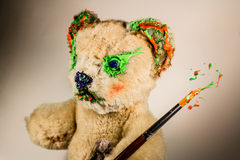 Teddy bear as an artist with paintbrush Stock Image