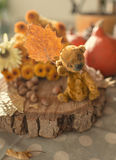 Teddy bear and autumn foliage Royalty Free Stock Image