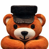 Teddy bear on the avatar in a cap on a white background. Avatar toy orange leather hat autumn looking at the table stock photography