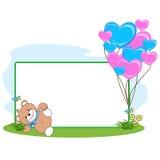 Teddy Bear avec le cadre de coeur Images stock