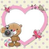 Teddy Bear avec un appareil-photo et un cadre de coeur Image stock