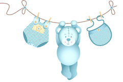 Teddy bear baby boy hanging on a clothesline Royalty Free Stock Photography