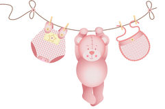 Teddy bear baby girl hanging on a clothesline Royalty Free Stock Photography