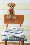 Teddy bear in a baby room Stock Photos