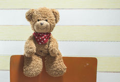 Teddy bear in a baby room. On chair Stock Photography