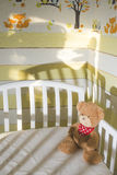Teddy bear in a baby room Stock Images