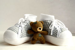 Teddy bear and baby's shoes 2 Stock Images