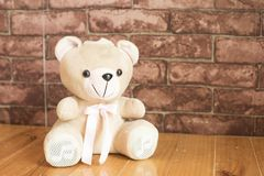 Teddy Bear on the background the brown wallpaper. Royalty Free Stock Photos