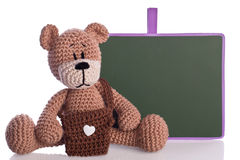 Teddy bear with bag and blackboard Royalty Free Stock Photo