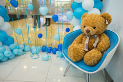 Teddy bear with balloon. Teddy bear sit on the chair with balloon Royalty Free Stock Photography