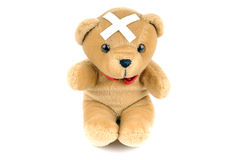 Teddy bear with a bandage Stock Images
