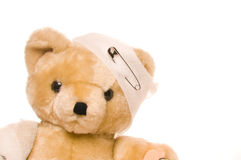 Teddy bear with bandage. And safety pin Royalty Free Stock Photo