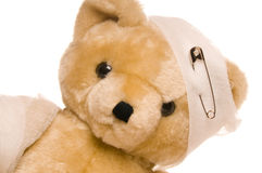 Teddy bear with bandage. Teddy bear with a hurted head and arm Stock Images