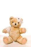 Teddy bear with bandage. Teddy bear with a hurted head and arm Stock Photography