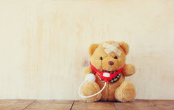 Teddy Bear with Bandage and stethoscope stock photo
