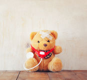 Teddy Bear with Bandage and stethoscope Stock Photography