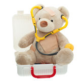 Teddy Bear with Bandages and Child Medical Kit. Teddy Bear with Bandages sitting in a Child Medical Kit wearing a stethoscope to play doctor, open  full of Royalty Free Stock Photo