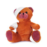 Teddy bear with bandages in its head, arm and leg Stock Photos