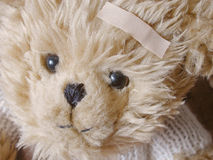 Teddy bear with bandaid Royalty Free Stock Photography