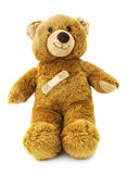 Teddy bear with a bandaid. Isolated teddy bear with a bandaid — child health care royalty free stock image