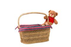 Teddy bear with basket. Teddy bear toy with wicker basket Stock Photos