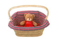 Teddy bear  in basket. Teddy bear toy in wicker basket Royalty Free Stock Photography