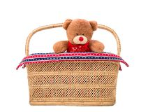 Teddy bear in basket. Teddy bear toy in wicker basket on white background Royalty Free Stock Photos