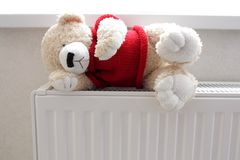 Teddy bear on the battery Stock Image