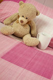 Teddy Bear in Bed Royalty Free Stock Photo