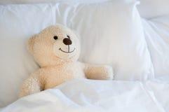 Teddy bear on bed stock photo