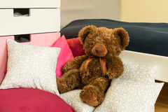 Teddy bear on bed Stock Image