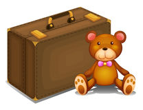A teddy bear beside a big bag Royalty Free Stock Image