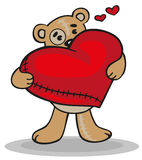 Teddy bear with big heart Stock Images