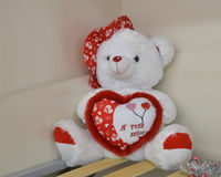 Teddy bear and big red heart with text Stock Photos
