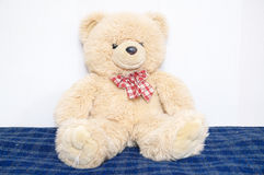 Teddy bear big toy portrait, childhood concept, friend and buddy, sitting on bed Stock Photography