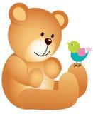 Teddy bear with bird Royalty Free Stock Photo